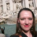 Me with a side view of the Trevi Fountain